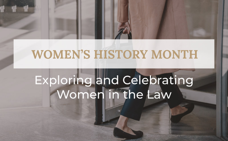 Women in long coat with briefcase walking through door with title Women's History Month