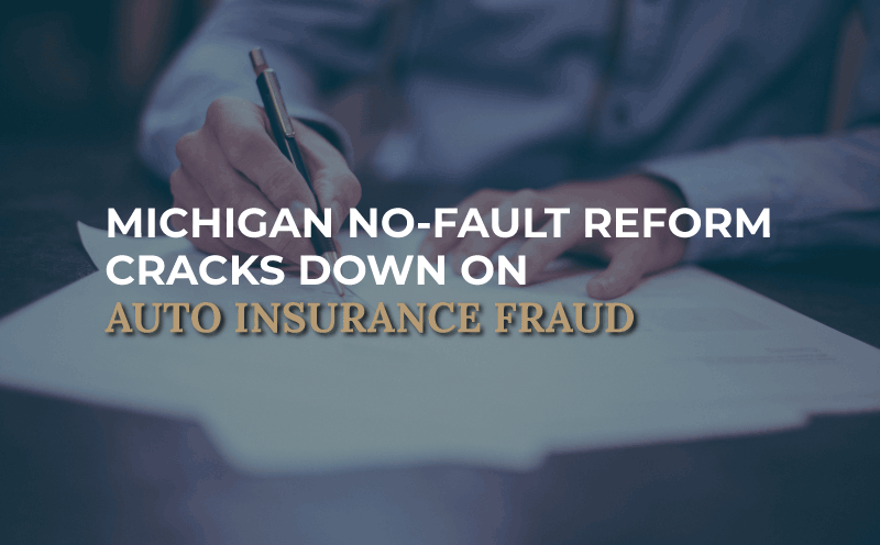 """person at desk with paperwork, image says """"Michigan No-Fault Reform Cracks Down on Auto Insurance Fraud"""""""