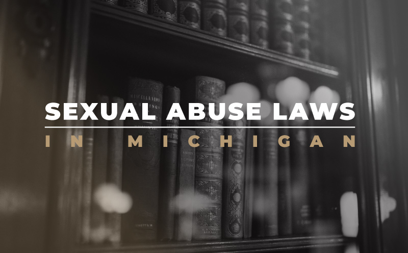 """black and white image of books on bookshelf with """"sexual abuse laws in michigan"""" text"""