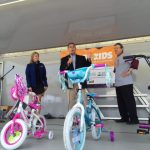 Lansing bike helmet giveaway George on stage