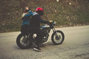 couple-riding-motorcycle-helmets