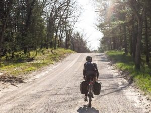 bryan-waldman-riding-bike-on-gravel-michigan-road