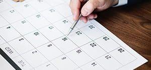 calendar-pen-hand