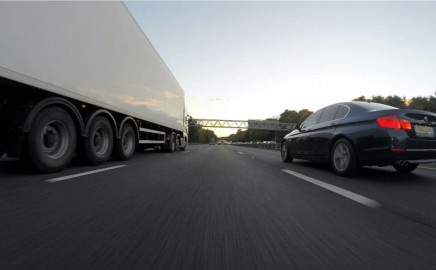 semi-truck-and-car-on-highway