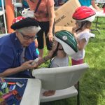 Lansing bike helmet giveaway face painting