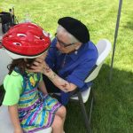 Lansing bike helmet giveaway face painting 3