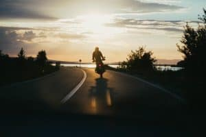 motorcycle-highway-sunset
