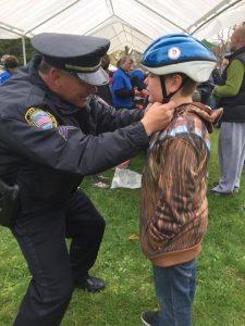 officer-helping-fit-bike-helmet