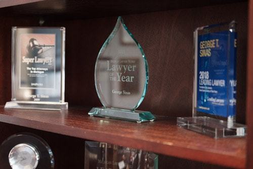 shelf featuring several awards
