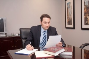 tom-sinas-attorney-at-desk